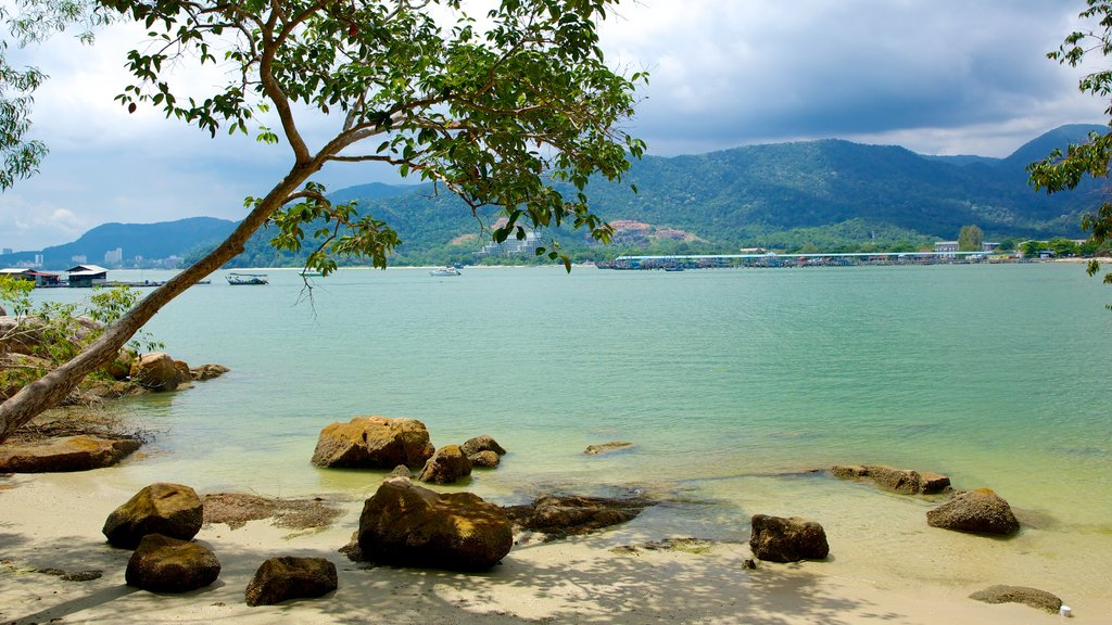 Penang National Park which includes a sandy beach, tropical scenes and a bay or harbor