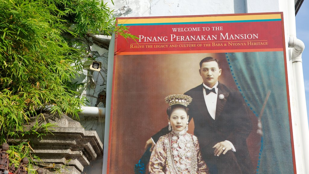 Pinang Peranakan Mansion featuring signage and chateau or palace