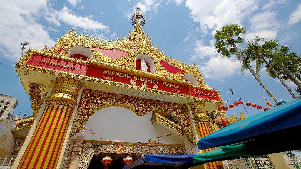 Templo budista Dhammikarama Burmese mostrando señalización, aspectos religiosos y patrimonio de arquitectura