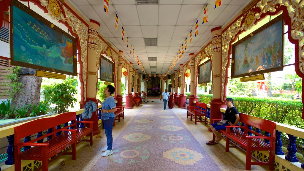 Dhammikarama Burmese Buddhist Temple featuring interior views, religious elements and a temple or place of worship