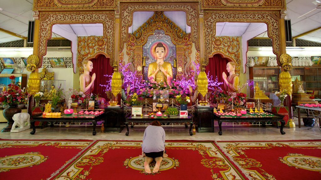 Dhammikarama Burmese Buddhist Temple showing a temple or place of worship, interior views and religious aspects