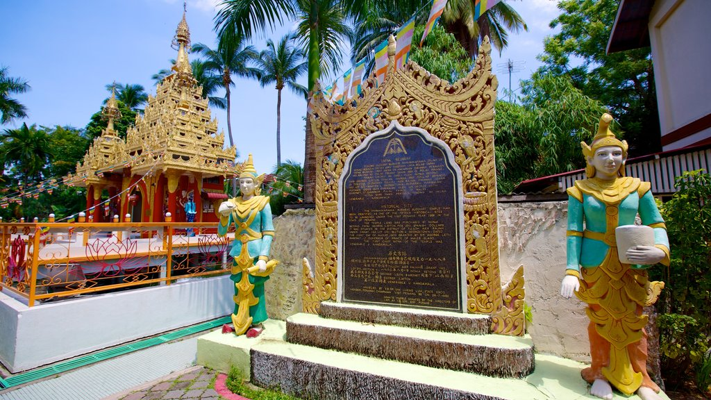 Dhammikarama Burmese Buddhist Temple featuring a temple or place of worship, religious elements and a memorial