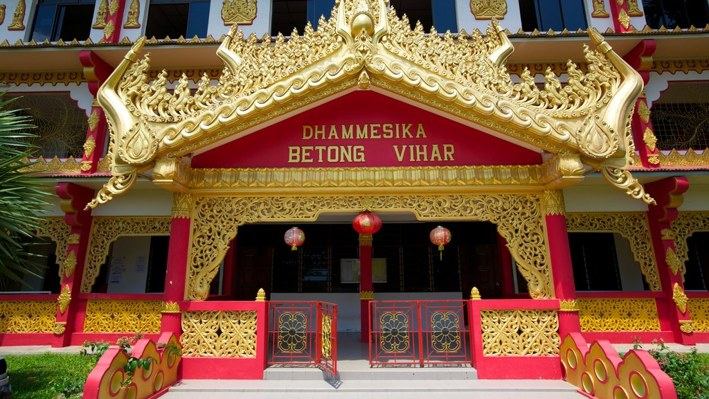 Dhammikarama Burmese Buddhist Temple showing signage, a temple or place of worship and religious elements