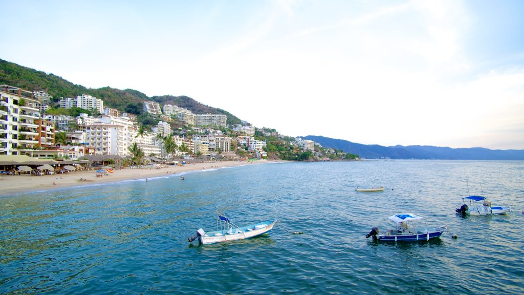 Bay of Banderas which includes a coastal town, boating and a beach
