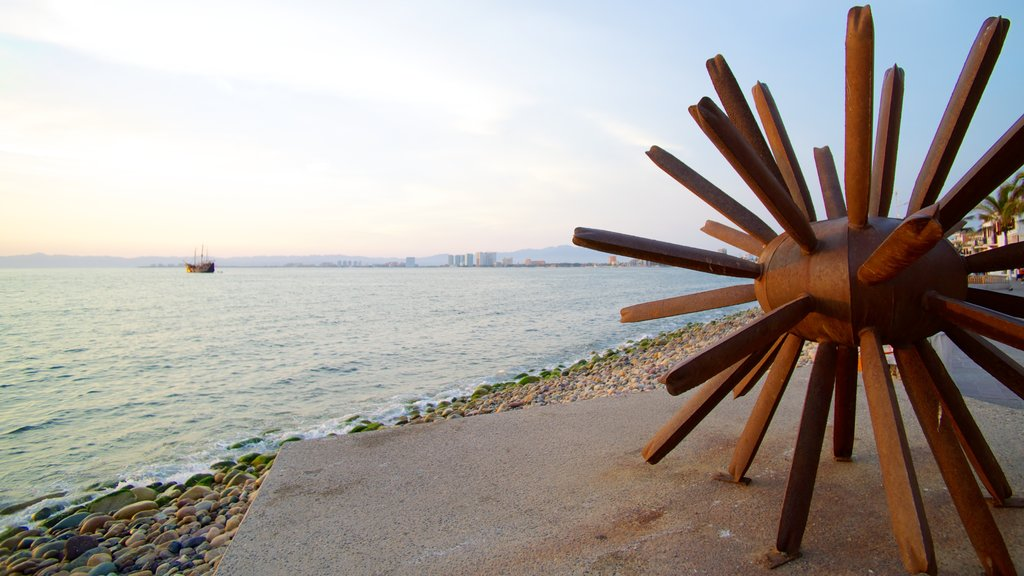 Bay of Banderas showing outdoor art and a pebble beach