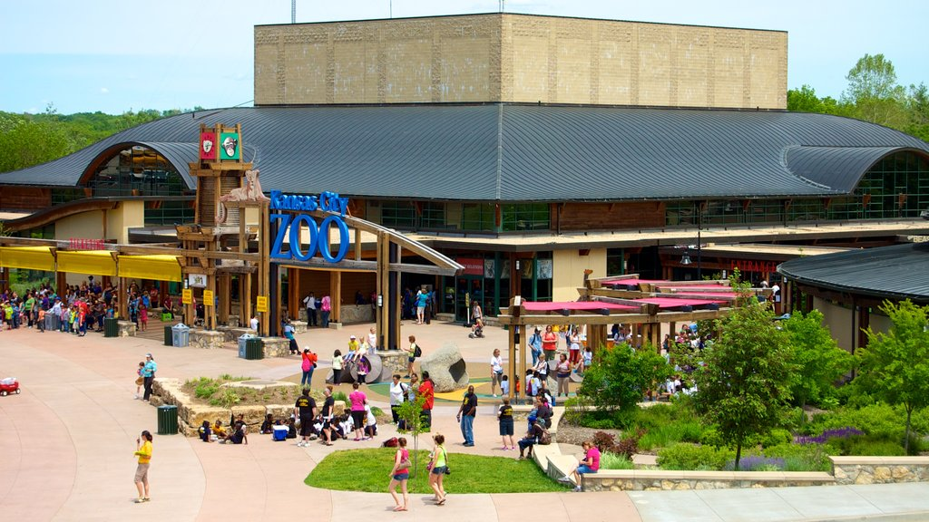 Kansas City Zoo which includes signage and zoo animals as well as a large group of people