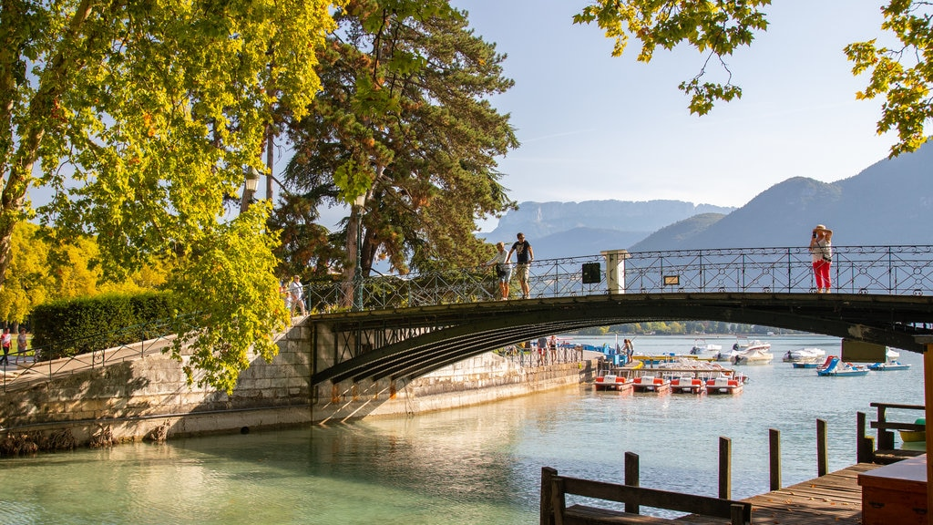 Amours Bridge which includes a bridge, a bay or harbor and a river or creek
