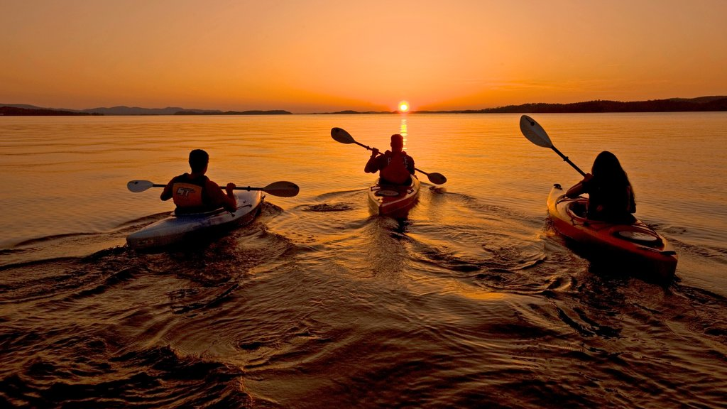 Central Arkansas featuring a sunset, kayaking or canoeing and general coastal views