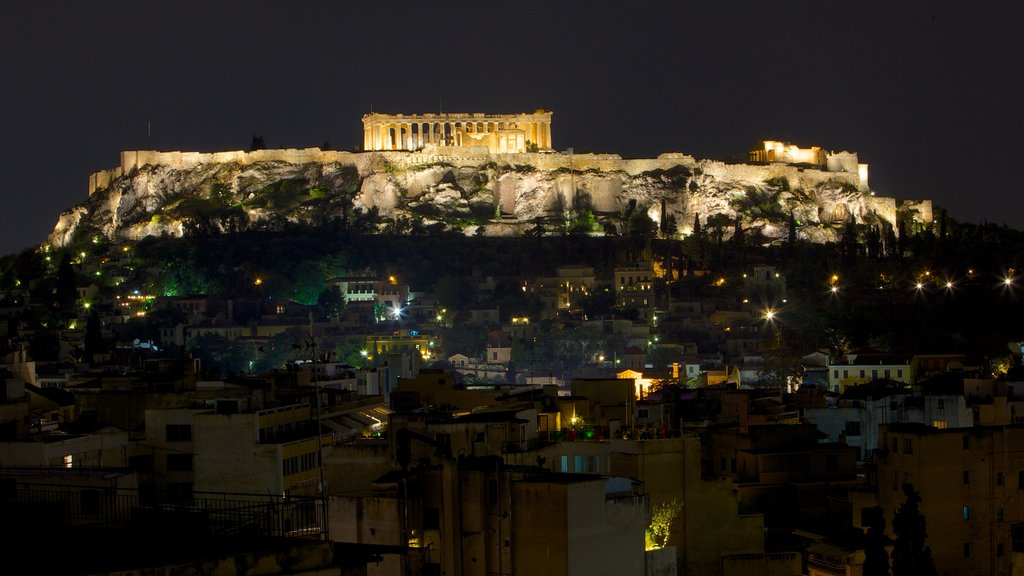 Acropolis showing heritage architecture, a ruin and night scenes
