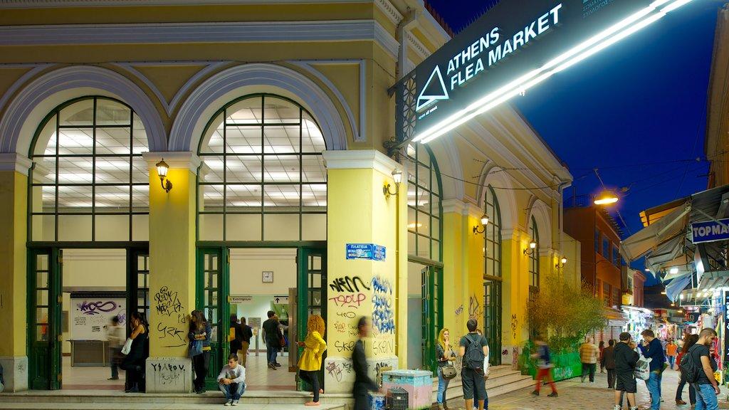 Monastiraki Flea Market featuring markets, night scenes and a city