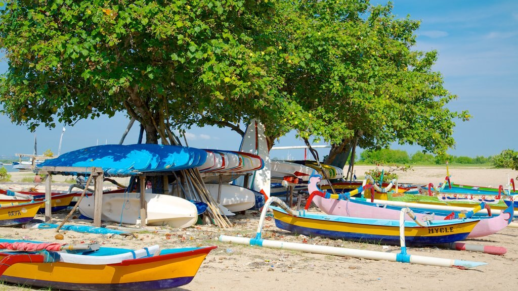 Sanur Beach which includes boating, a beach and tropical scenes
