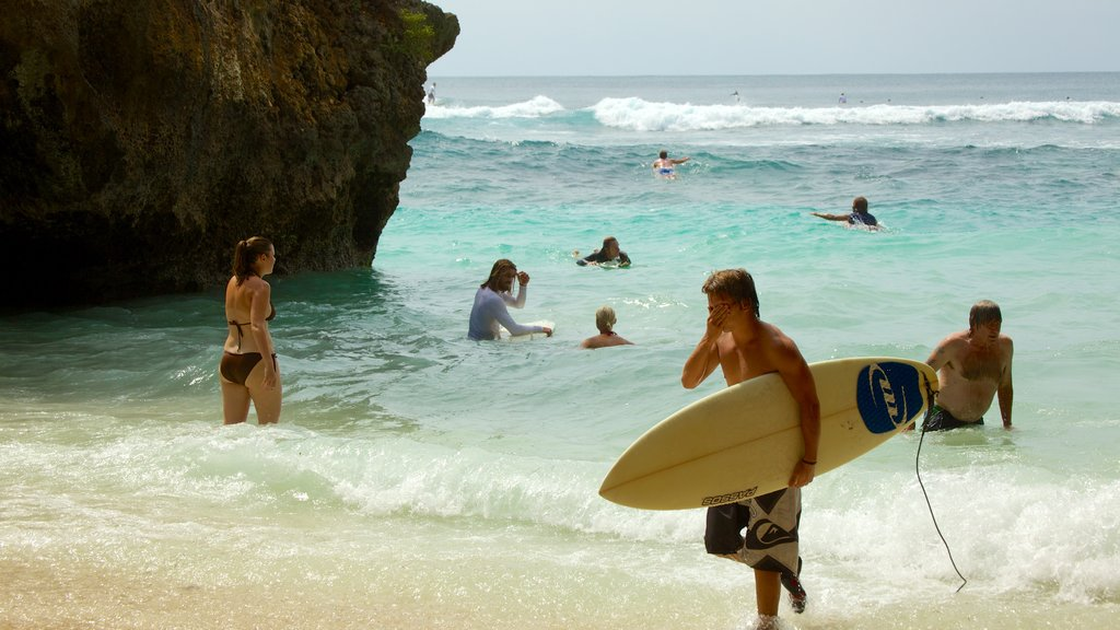 Uluwatu Beach which includes swimming, a sandy beach and surfing