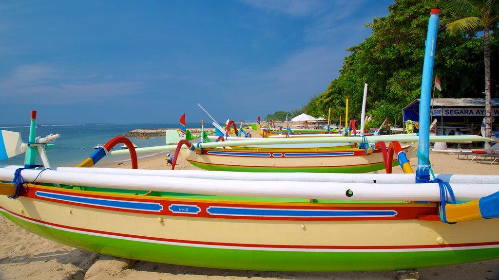Segara Beach which includes tropical scenes, a sandy beach and boating