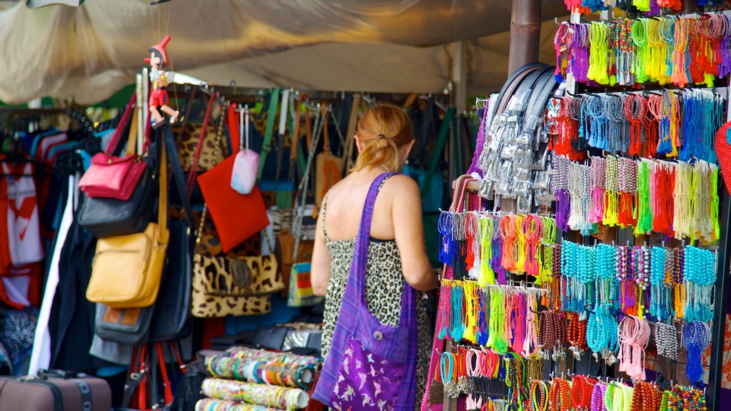 Seminyak Square featuring shopping and markets as well as an individual femail