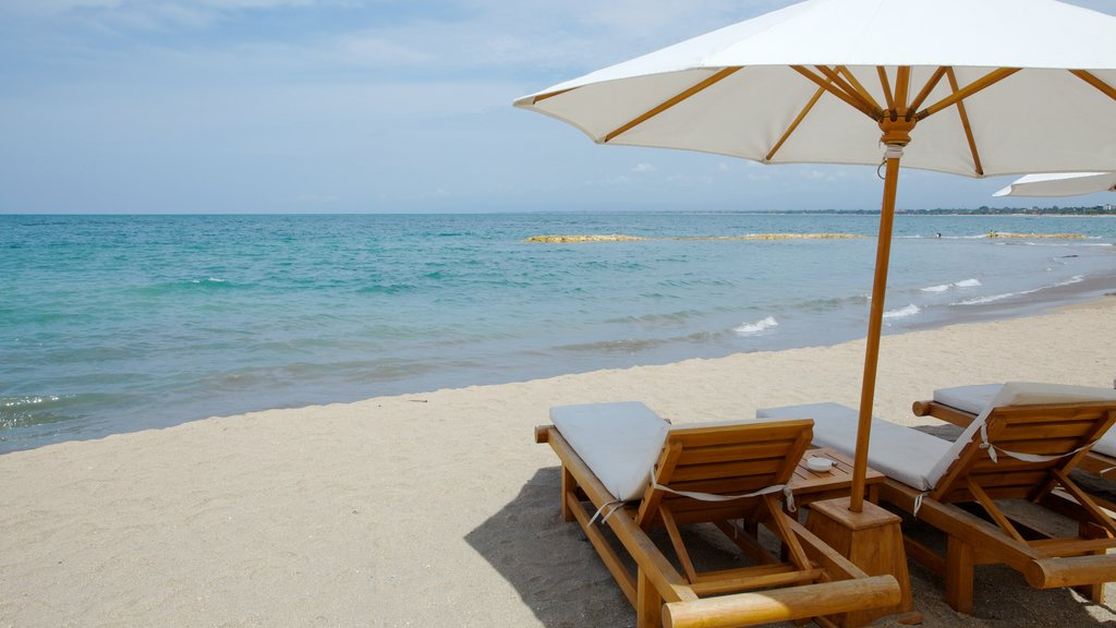 Kuta featuring a luxury hotel or resort and a sandy beach