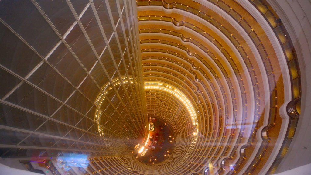 Jin Mao Tower which includes modern architecture, a city and interior views
