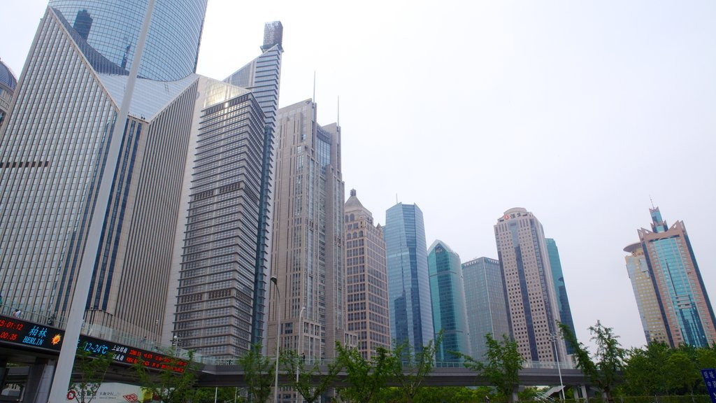 Jin Mao Tower which includes city views, a city and a skyscraper
