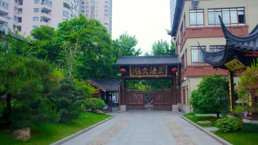 Jade Buddha Temple which includes a garden, religious elements and a temple or place of worship