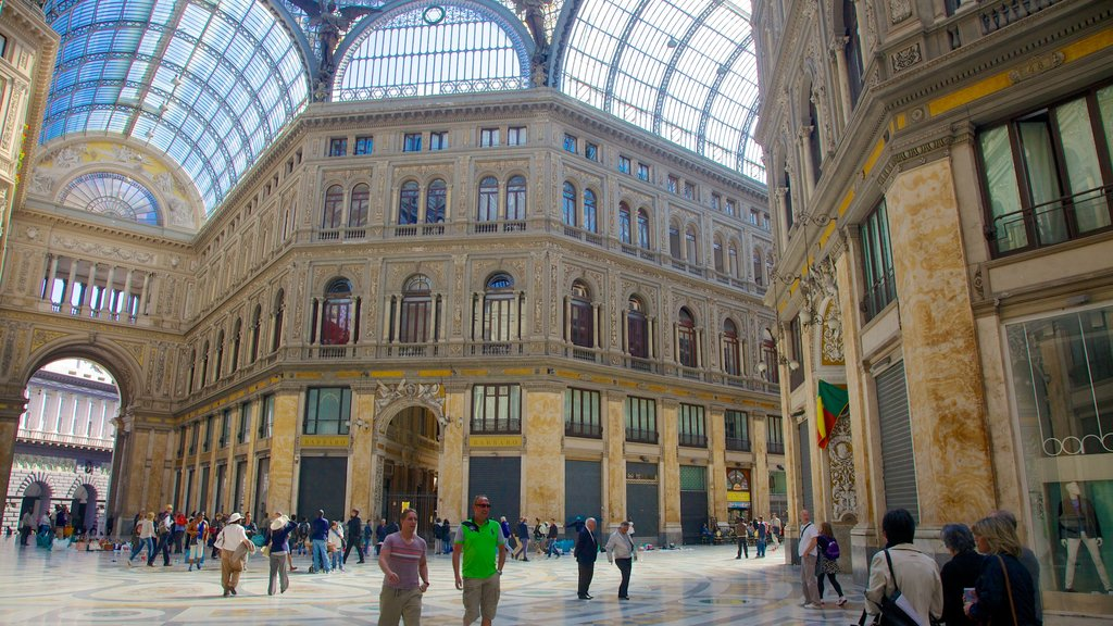 Galleria Umberto I showing interior views and shopping as well as a large group of people