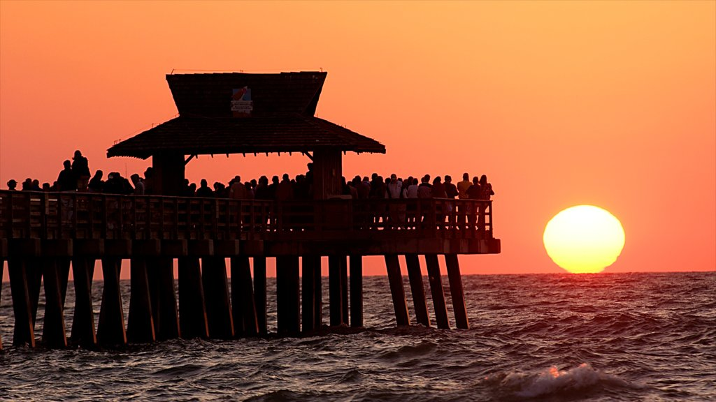 Sanibel Captiva Island showing general coastal views and a sunset as well as a large group of people