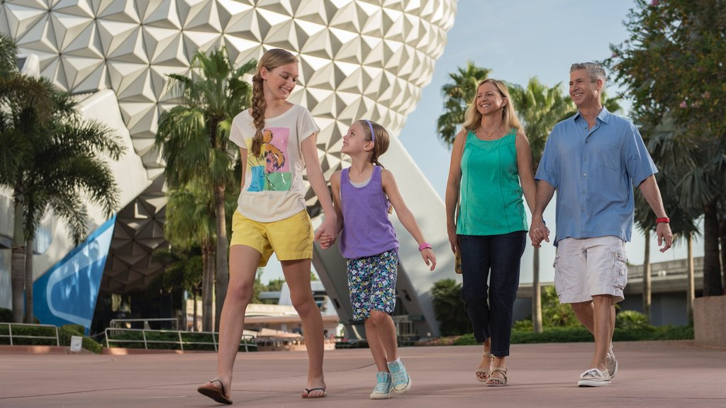 Epcot® showing street scenes as well as a family