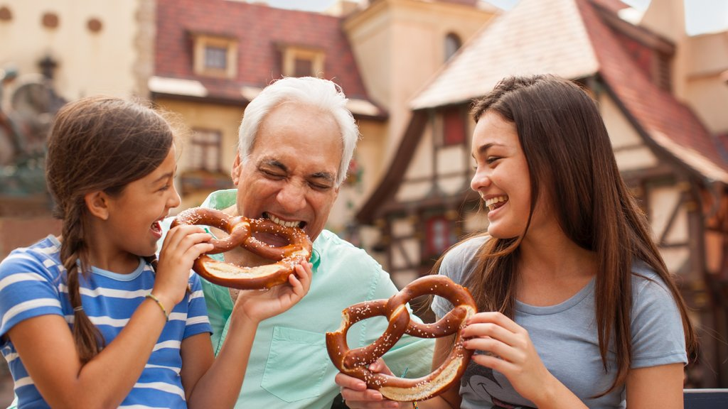 Epcot® showing food as well as a family