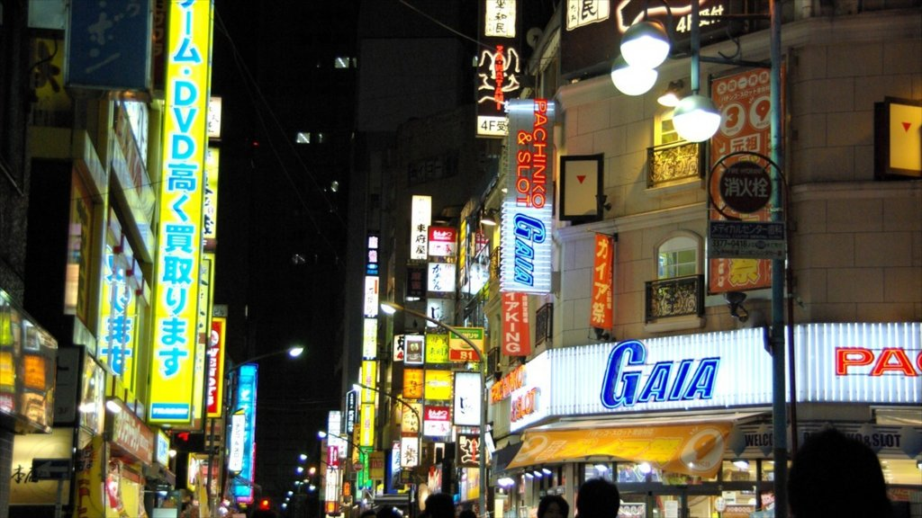 Shinjuku showing night scenes, street scenes and a city