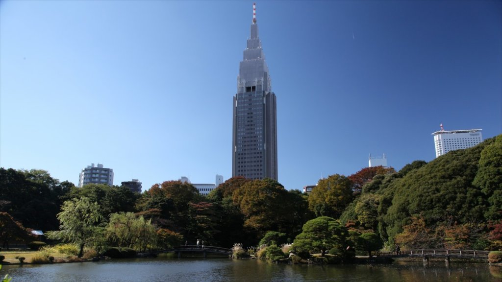 Shinjuku which includes a park and a pond