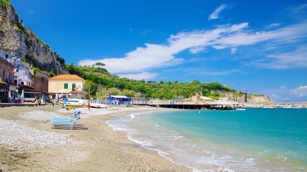 Marina di Puolo featuring a bay or harbor, a pebble beach and a coastal town