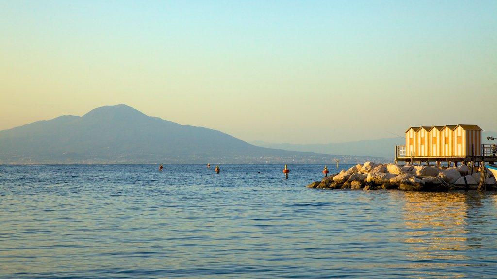 Marina Grande showing rocky coastline and a sunset