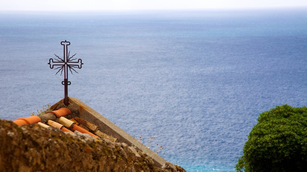 Positano which includes religious aspects, a church or cathedral and general coastal views