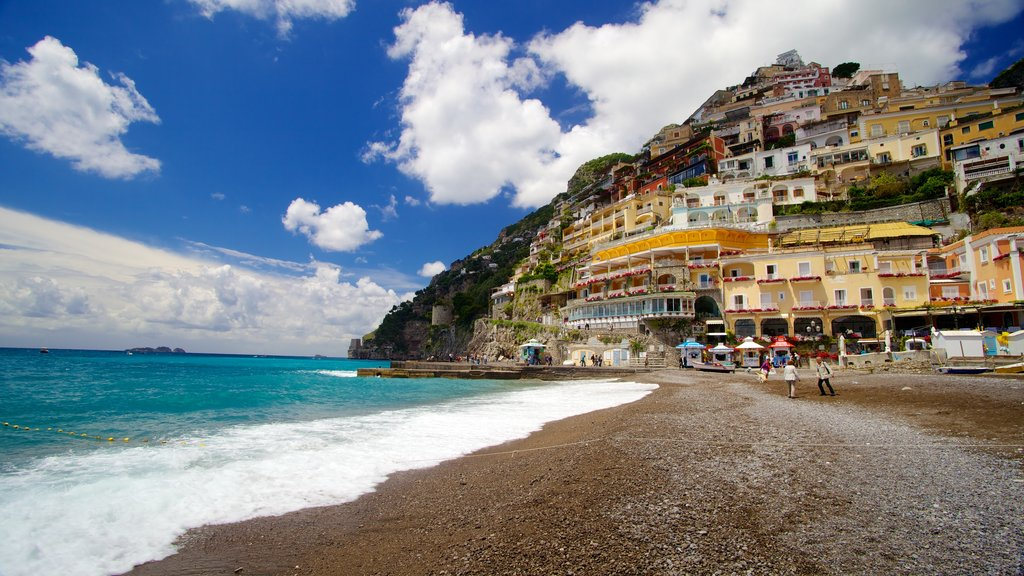 Positano which includes a beach and a coastal town