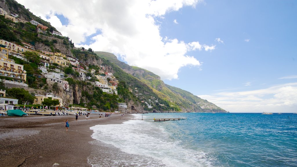 Positano showing a sandy beach, mountains and a coastal town