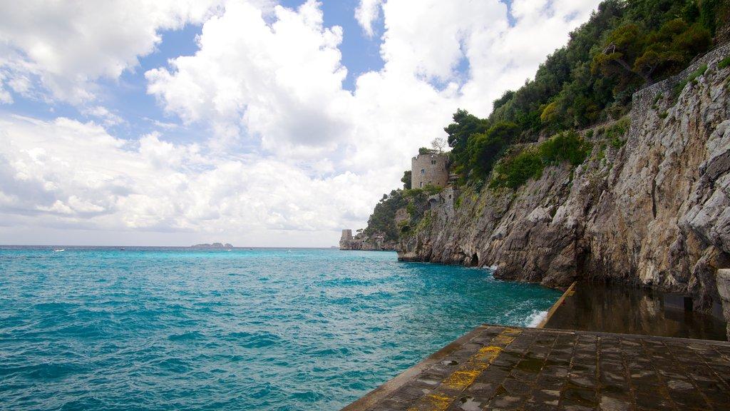 Positano featuring rocky coastline and general coastal views