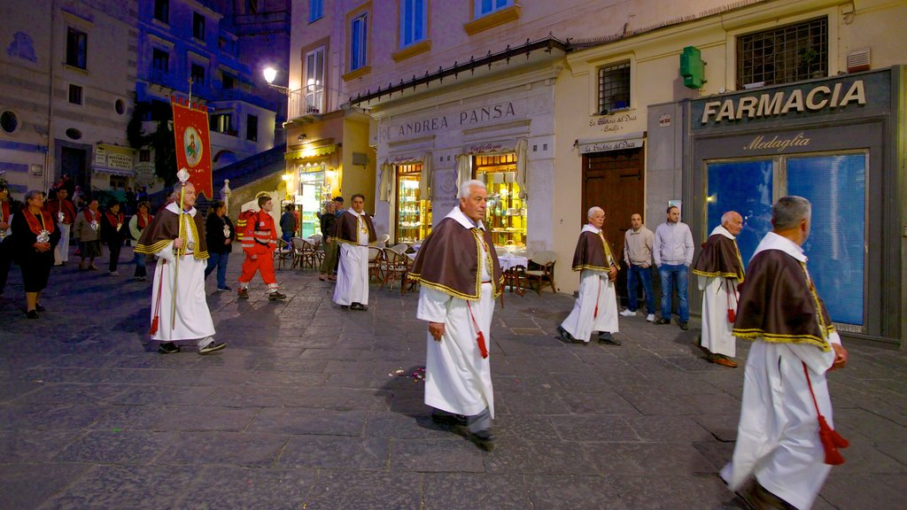 Amalfi featuring night scenes, street scenes and religious aspects