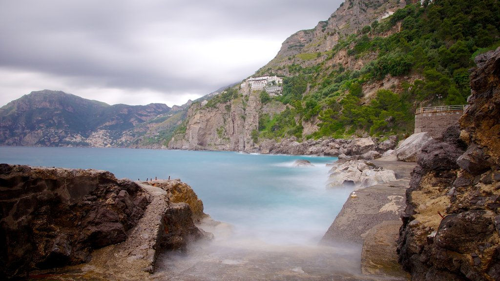 Praiano featuring mist or fog, general coastal views and rugged coastline