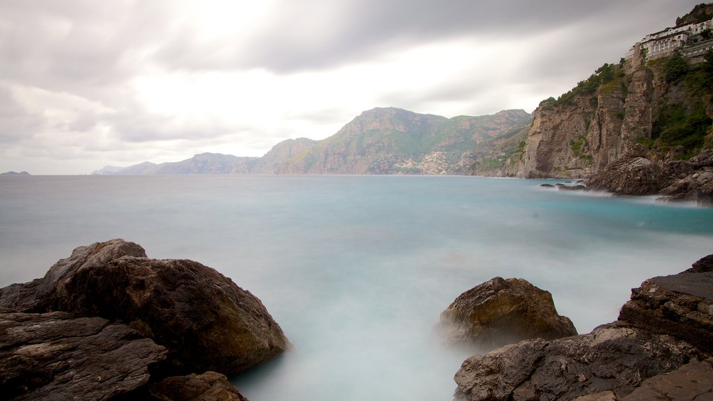 Praiano featuring mist or fog and rugged coastline