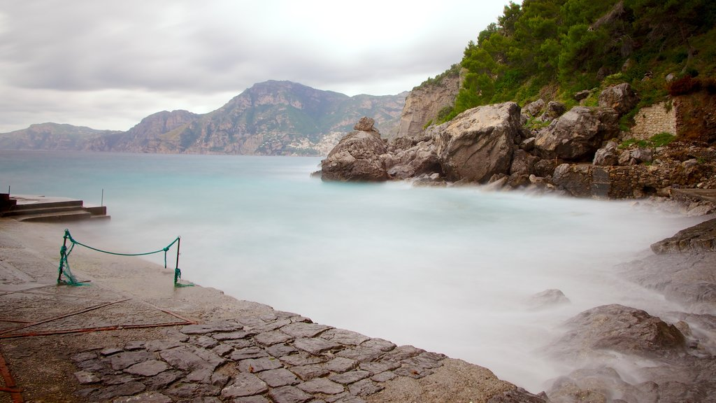 Praiano showing rugged coastline and mist or fog