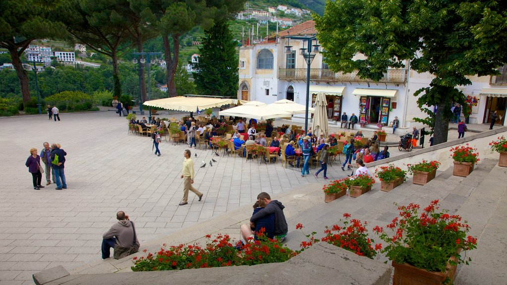 Ravello showing a square or plaza as well as a large group of people