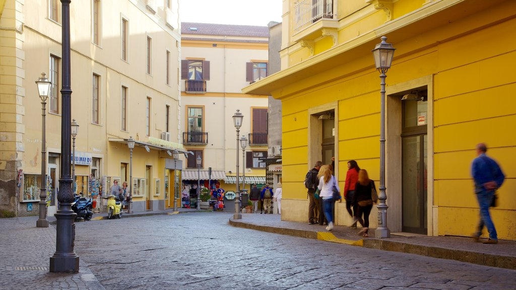 Sorrento featuring street scenes as well as a large group of people