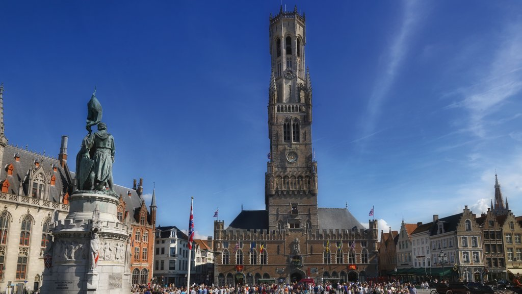 Bruges Belfry showing a city and heritage architecture as well as a large group of people