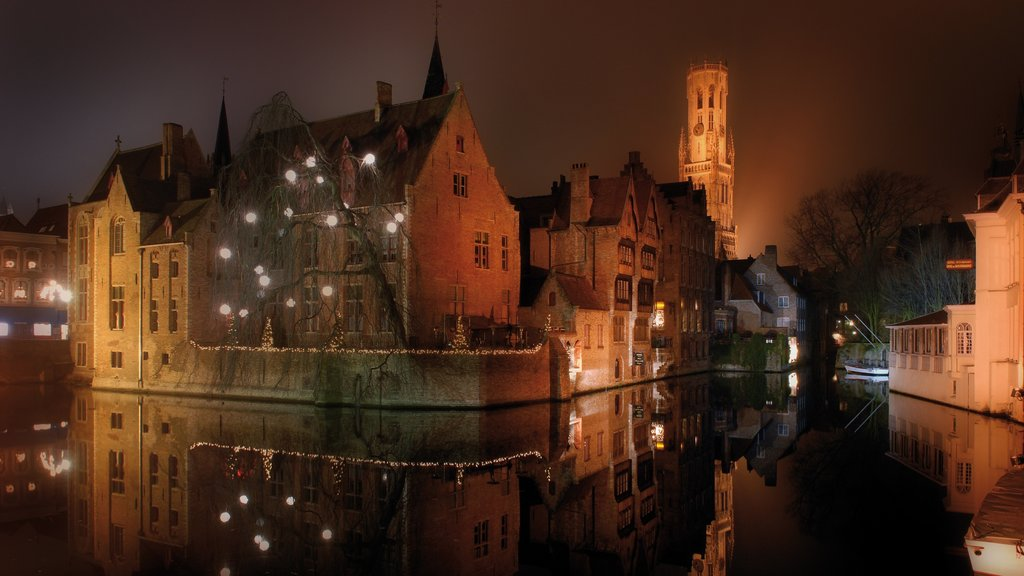 Bruges showing night scenes, mist or fog and a river or creek