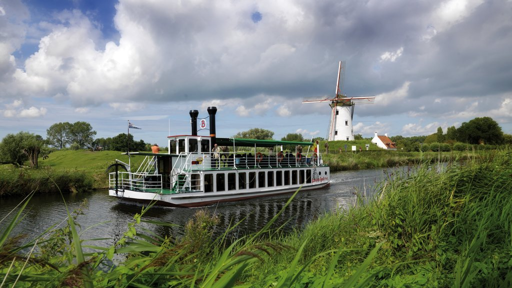 Bruges featuring a ferry, boating and a river or creek