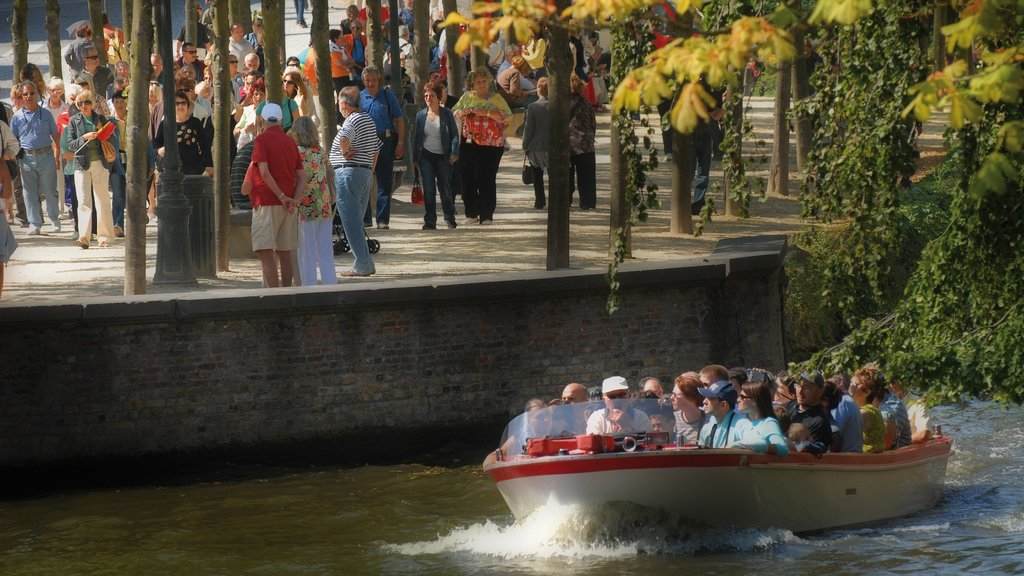 Bruges featuring boating and a river or creek as well as a large group of people