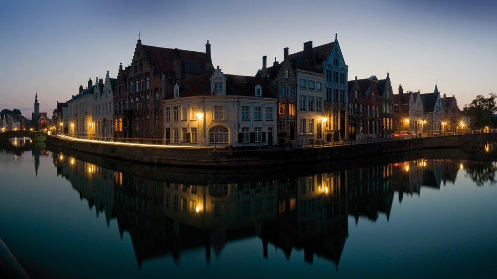 Bruges which includes a river or creek, night scenes and a city