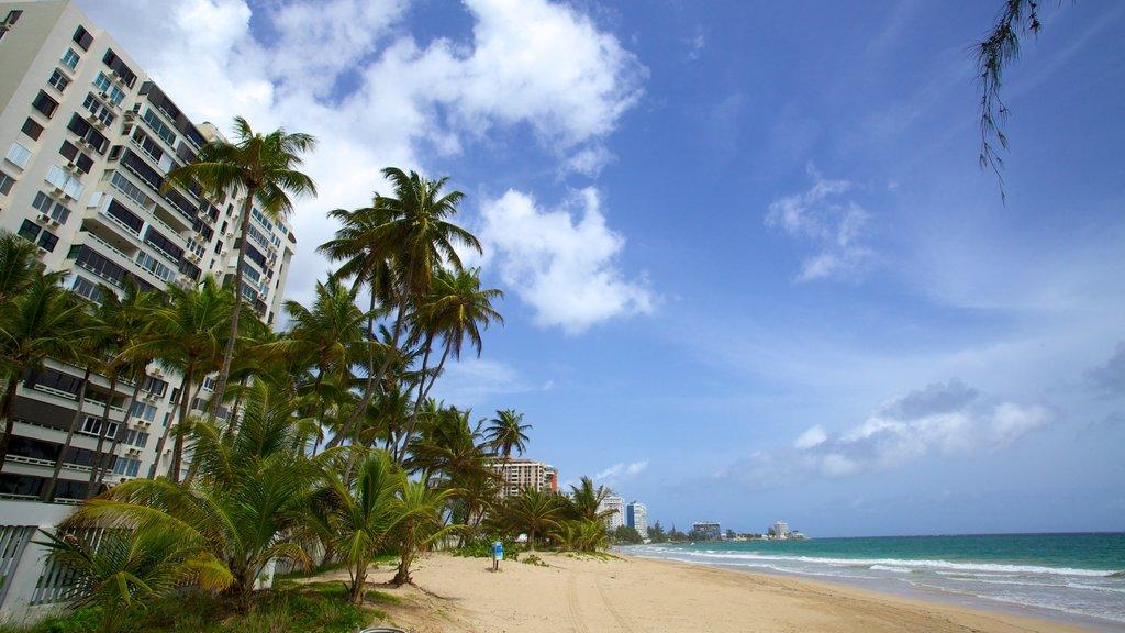 Isla Verde Beach which includes a hotel, a coastal town and a beach