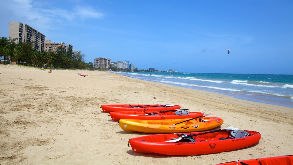 Isla Verde Beach featuring kayaking or canoeing and a beach