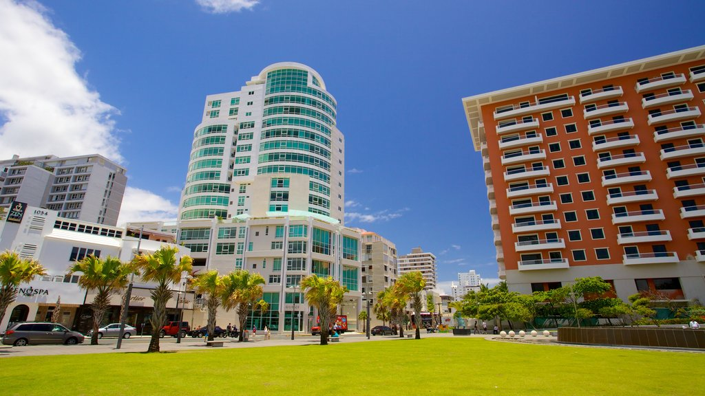 Condado Beach showing tropical scenes and a city