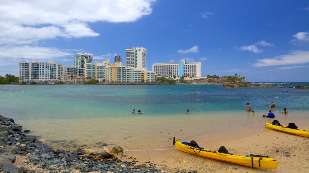 Condado Beach which includes swimming, a city and kayaking or canoeing