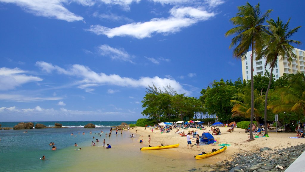 Condado Beach featuring kayaking or canoeing, a sandy beach and tropical scenes